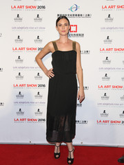 Odette Annable charmed in a lace-hem LBD with golden shoulder straps while attending the LA Art Show opening.