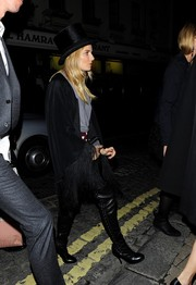 Over-the-knee leather boots sealed off Sienna Miller's party ensemble.