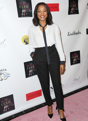 Garcelle Beauvais kept it breezy in a monochrome striped tie-neck blouse during the 'Woman Code' event.