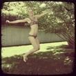 Gwyneth Paltrow Jumps for Joy in a Snake Bikini