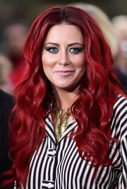 Aubrey O'Day wore her bright hair in big bouncy curls during a taping of 'Celebrity Apprentice.'