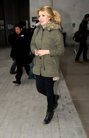 Holly Willoughby kept her street style simple and casual with this green utility jacket with a cozy fur hood.