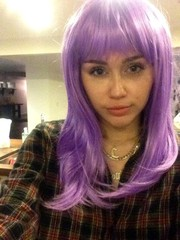 Miley Cyrus looked adorable wearing a lilac wig in this social media pic.