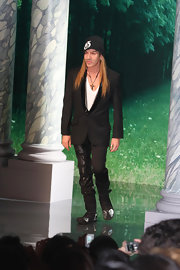 John closed out the Dior show during Fashion Week in a black suit and knit beanie.