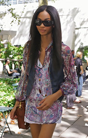 Chanel is showing her bohemian style with a plain straight cut with her floral top and jean vest.
