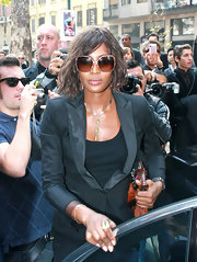 While attending fashion week Naomi showed off her newly shortened bob which she gave some slight waves for added volume.