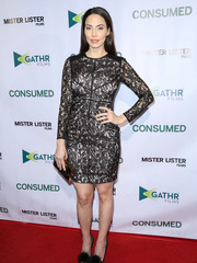 Whitney Cummings chose a classic black lace dress with a gold underlay for the premiere of 'Consumed.'