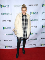 Busy Philipps arrived for the premiere of 'Consumed' wearing a cream-colored fur coat over a plaid shirtdress.