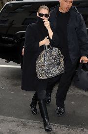 Celine Dion punctuated her black look with a printed tote.