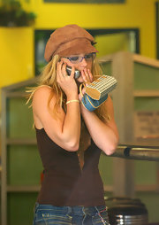 Britney Spears donned a brown suede newsboy cap while walking out in LA.
