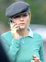 Kirsten goes casual in this stylish tweed cap.