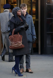 Tika Sumpter looked posh carrying a cognac suede tote encircled by leather straps and gold chains.