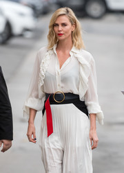 Charlize Theron teamed an oversized belt with a ruffle blouse and a pleated skirt, all by Givenchy, for her appearance on 'Kimmel.'