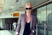 ****NO GERMANY / SWITZERLAND****.Actress Charlize Theron is seen arriving at Heathrow airport on a flight from Los Angeles.