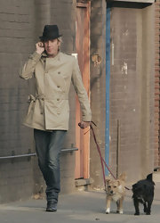 Rhys walked the dogs in style in a tan military jacket.