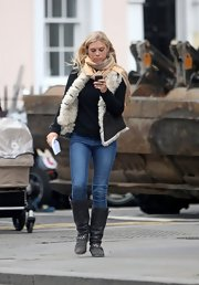 Chelsy Davy toughened her street attire with gray suede motorcycle boots.