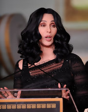Cher looked flawless with her sculpted curls during her hand and footprint ceremony.