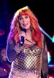 Cher was rocker-chic at the Gay Pride dance in a gold vest layered over a mesh top.