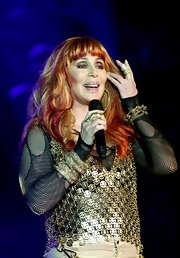 Cher loaded up on the sparklies with this gold link bracelet, cuff bracelet, and metal vest combo at the Gay Pride dance.