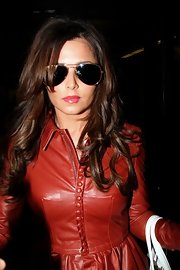 Cheryl Cole made her way through LAX in gold-framed aviators.