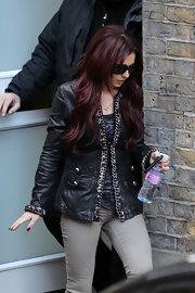 Seen leaving XFM Studios, Cheryl Cole was spotted in a leather jacket with chain detailing.