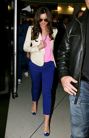 Cheryl Cole traveled in style in vibrant blue Mago suede platforms with cream trim.