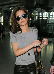 Making her way through Heathrow Airport Cheryl Cole is seen looking a little down. Although you can't really tell with her aviator shades shielding her face.