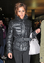 "Cheryl wore a large silver ""Heart and Skull"" ring with red Swarovski crystal embellishments."