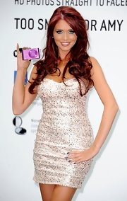 Amy Childs swept on pearly blue-gray nail lacquer for a Samsung promotional event.