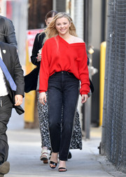 Chloe Grace Moretz looked vibrant in her red Christopher Kane V-neck sweater while out in LA. Wearing it off one shoulder added a hint of sexiness.