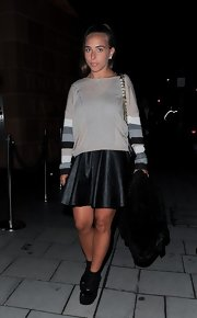 Chloe Green dressed down her leather dress with this gray striped sweatshirt.