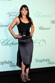 Michelle Rodriguez looked oh-so-hot in her black strappy sandals and sultry outfit at the Chopard Trophy party.