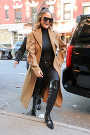 Chrissy Teigen completed her winter-chic ensemble with black thigh-high boots.