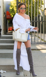 Chrissy Teigen pulled her funky look together with a pair of gray thigh-high boots by Le Silla.