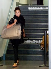 Chrissy Teigen was spotted at LAX carrying a massive nude leather tote.