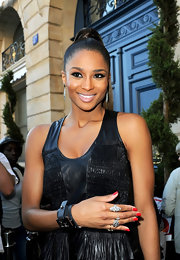 To recreate Ciara's cool, retro liner look, start by sweeping black liquid liner across the upper and lower lids, as close to the lash lines as possible and from the very inner corners to just slightly past the outer corners. An eye pencil may also be used, but the effect is usually not quite as precise. To finish the look, use an eye pencil to line the inner rims of eyes and add a few coats of a volumizing mascara.