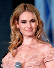 Lily James paired a wavy 'do with a frothy pink gown for total sweetness at the Tokyo premiere of 'Cinderella.'