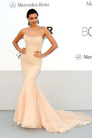 Irina masterfully joined sexy with glamorous in this cream mermaid gown at the amfAR Gala.