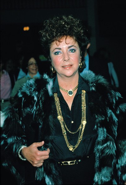 Elizabeth Taylor's gold chain necklace looked striking against her black outfit.