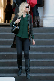 Claudia Schiffer always looks effortlessly chic while running her daily errands. Here the model sports black knee high boots that are ever so slightly slouchy.