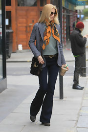 Claudia dons one of her signature colorful print scarves while out in Notting Hill.