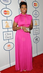 Fantasia Barrino looked sweet and girly in a bright pink evening dress during Clive Davis' pre-Grammy gala.