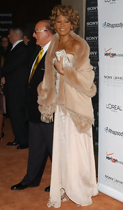 Whitney Houston wrapped a fur shawl around her shoulder as a cover-up to her strapless gown at the pre-Grammy party.