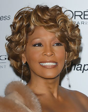 Whitney Houston looked timeless with her golden short curls at the pre-Grammy 2007 party.
