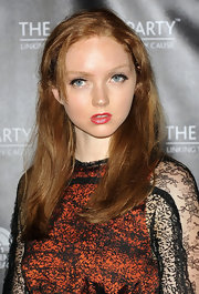 Lily Cole opted for a simple long side-parted hairstyle when she attended the Global Party launch.