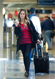 Lauren Conrad added collegiate appeal to her airport style with a navy wool pea coat.