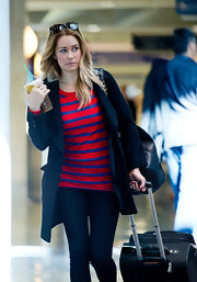 Lauren Conrad kept her California casual style classic at the airport with a red and blue striped shirt.
