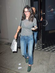 For a pop of color, Courteney Cox accessorized with a pair of green suede loafers.