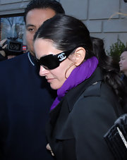 Courtney Cox showed off a pair of dark sunglasses.