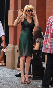 Singer Courtney love has a band tattoo on her left ankle.